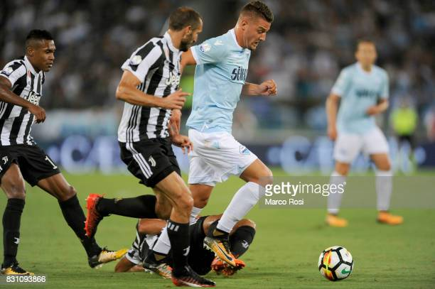 Sergej Milinkovic Savic of SS Lazio competes for the ball with Giorgio Chiellini of FC Juventus during the Italian Supercup match between Juventus...