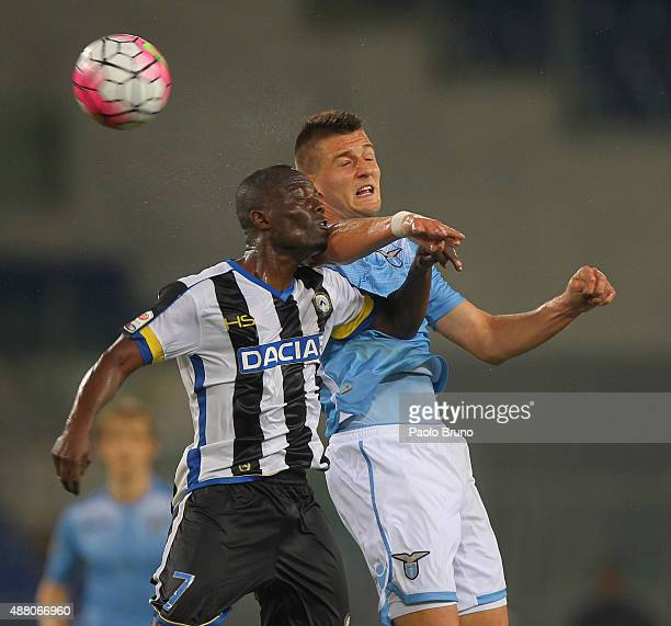 Sergej MilinkovicSavic of SS Lazio competes for the ball with Emmanuel Badu of Udinese Calcio during the Serie A match between SS Lazio and Udinese...