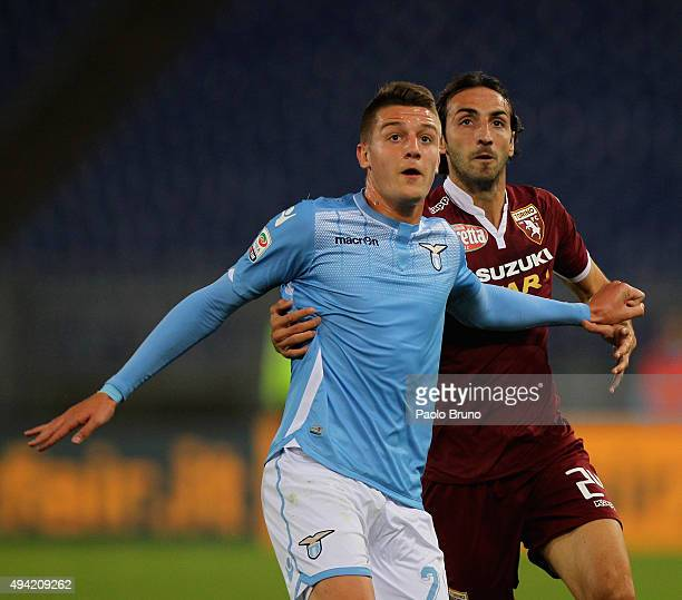 Sergej MilinkovicSavic of SS Lazio competes for the ball with Emiliano Moretti of Torino FC during the Serie A match between SsS Lazio and Torino FC...