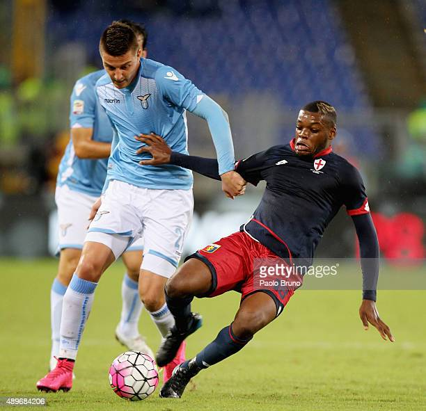 Sergej MilinkovicSavic of SS Lazio competes for the ball with Olivier Julies Ntcham of Genoa CFC during the Serie A match between SS Lazio and Genoa...