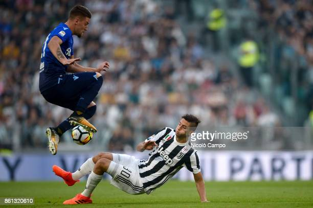 Sergej MilinkovicSavic of SS Lazio is tackled by Rodrigo Bentancur of Juventus FC during the Serie A football match between Juventus FC and SS Lazio...