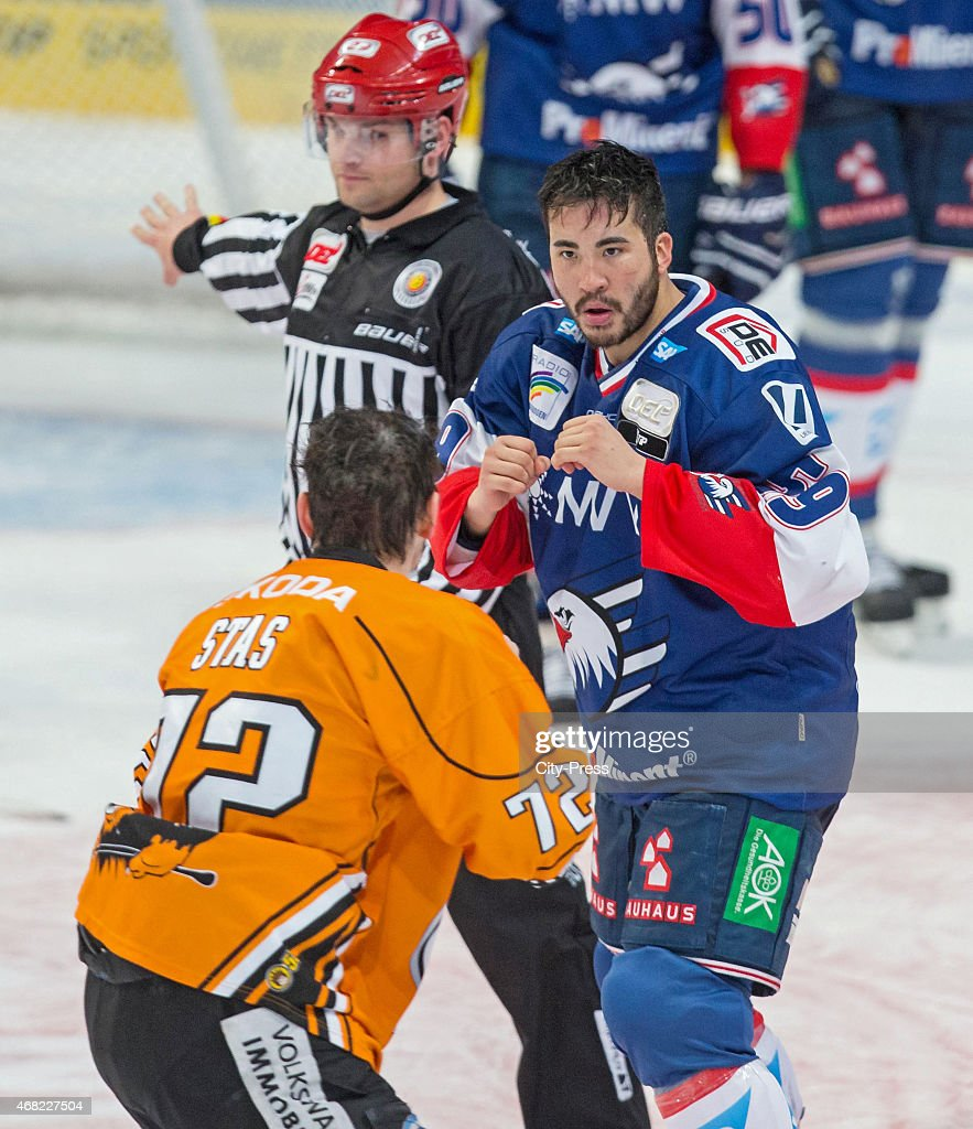 Sergej Stas of the Grizzly Adams Wolfsburg and Brandon Yip of the Adler Mannheim have a fight during the game between Adler Mannheim and Grizzly...