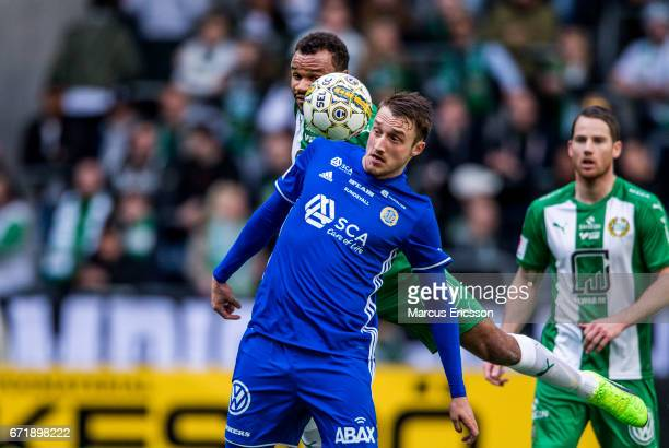 SergeJunior Martinsson Ngouali of Hammarby IF behind Smajl Suljevic of GIF Sundsvall during the Allsvenskan match between Hammarby IF and GIF...