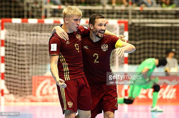 Sergey Abramov of Russia celebrates his goal with team mates during the FIFA Futsal World Cup semifinal match between Iran and Russia at Coliseo Ivan...