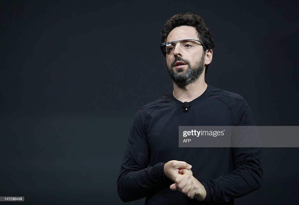 Sergey Brin, co-founder of Google appear at the keynote with the Google Glass to introduce the Google Class Explorer edition during Google's annual developer conference, Google I/O, on June 27, 2012 in San Francisco. AFP PHOTO/Kimihiro Hoshino