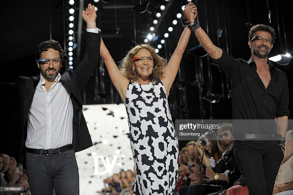 Sergey Brin, co-founder of Google Inc., from left, designers Diane Von Furstenberg and Yvan Mispelaere walk the runway while wearing Project Glass internet glasses at Von Furstenberg's fashion show in New York, U.S., on Sunday, Sept. 9, 2012. Google Inc., owner of the world's most popular search engine, will sell eyeglass-embedded computers to consumers by 2014 after incorporating feedback from developers, said Brin. Photographer: Peter Foley/Bloomberg via Getty Images