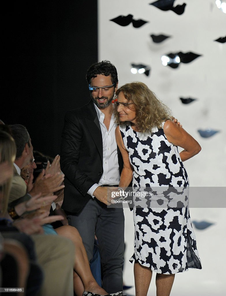 Sergey Brin, co-founder of Google Inc., left and designer Diane Von Furstenberg walk the runway while wearing Project Glass internet glasses at Von Furstenberg's fashion show in New York, U.S., on Sunday, Sept. 9, 2012. Google Inc., owner of the world's most popular search engine, will sell eyeglass-embedded computers to consumers by 2014 after incorporating feedback from developers, said Brin. Photographer: Peter Foley/Bloomberg via Getty Images