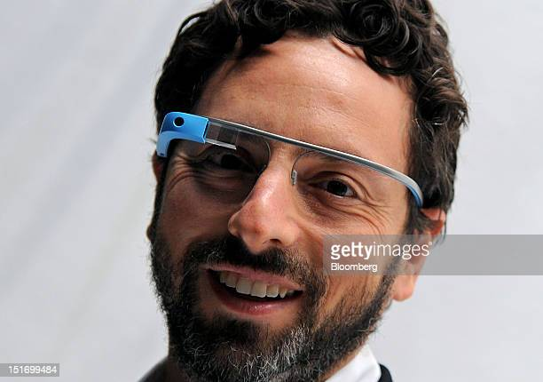 Sergey Brin cofounder of Google Inc stands for a photograph while wearing Project Glass internet glasses at the Diane Von Furstenberg fashion show in...