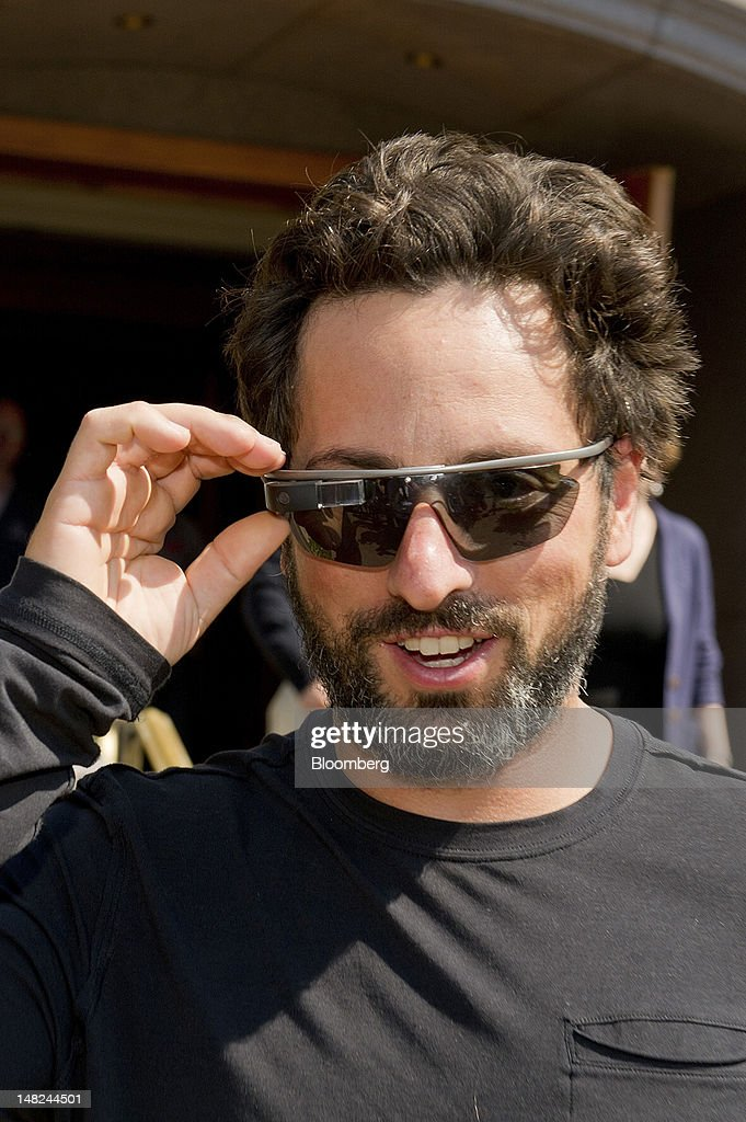 Sergey Brin, co-founder of Google Inc., wearing Project Glass internet glasses leaves the morning session during the Allen & Co. Media and Technology Conference in Sun Valley, Idaho, U.S., on Thursday, July 12, 2012. Media moguls gathered at the annual Allen & Co. conference have spent recent years contemplating how to cope with technology companies drawing audiences away from television and movies. Photographer: David Paul Morris/Bloomberg via Getty Images