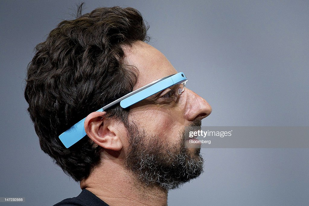 Sergey Brin, co-founder of Google Inc., wears Project Glass internet glasses while speaking at the Google I/O conference in San Francisco, California, U.S., on Wednesday, June 27, 2012. Google Inc. unveiled a $199 handheld computer called the Nexus 7 that features a 7-inch screen and is designed to help the company vie with Apple Inc., Microsoft Corp. and Amazon.com Inc. in the surging market for tablets. Photographer: David Paul Morris/Bloomberg via Getty Images