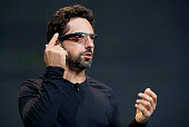 Sergey Brin cofounder of Google Inc wears Project Glass internet glasses while speaking at the Google I/O conference in San Francisco California US...