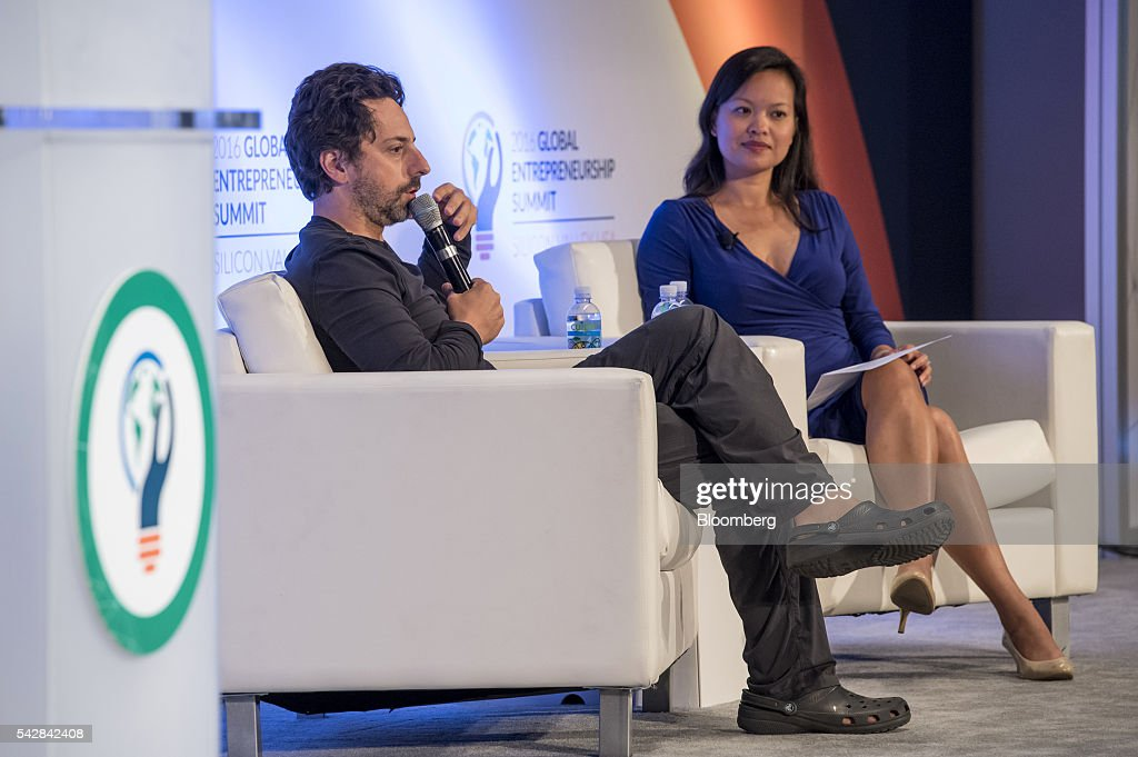 <a gi-track='captionPersonalityLinkClicked' href=/galleries/search?phrase=Sergey+Brin&family=editorial&specificpeople=753551 ng-click='$event.stopPropagation()'>Sergey Brin</a>, president of Alphabet and co-founder of Google Inc., speaks as Mary Grove, director of Google for Entrepreneurs, listens during the 2016 Global Entrepreneurship Summit (GES) at Stanford University in Stanford, California, U.S., on Friday, June 24, 2016. The annual event brings together entrepreneurs from around the world for 3 days of networking, workshops and conferences. Photographer: David Paul Morris/Bloomberg via Getty Images