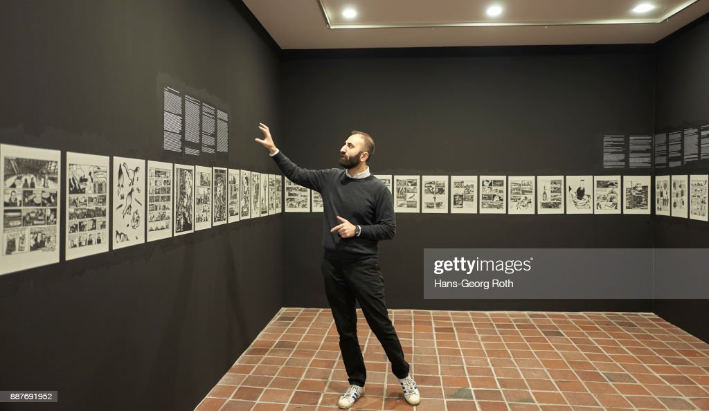 Sergey Harutoonian, curator, explaining the art work of Richard Leue, seen during the 'Lisa Pahlke und Richard Leue - Kopf oder Zahl' Exhibition Preview at MMK3 In Frankfurt exhibition preview at MMK 3 on December 7, 2017 in Frankfurt am Main, Germany. The exhibition opens on December 8th and runs until February 4th 2018.