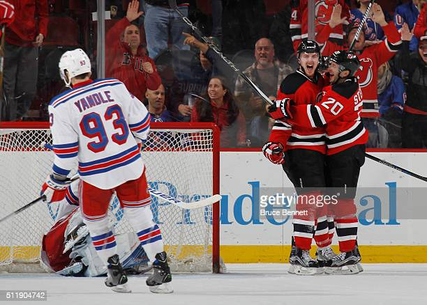 Sergey Kalinin of the New Jersey Devils celebrates his goal at 1716 of the third period against the New York Rangers and is joined by Lee Stempniak...