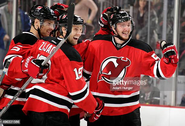 Sergey Kalinin of the New Jersey Devils celebrates with teammates after scoring a goal against the Vancouver Canucks during the second period at the...