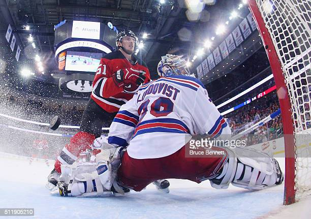 Sergey Kalinin of the New Jersey Devils scores at 1716 of the third period against Henrik Lundqvist of the New York Rangers at the Prudential Center...