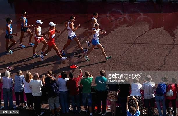 Sergey Kirdyapkin of Russia leads the pack during the Men's 50km Walk on Day 15 of the London 2012 Olympic Games at The Mall on August 11 2012 in...