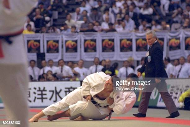 Sergey Kossorotov of Russia throws Shinichi Shinohara of Japan to win in the Men's Openweight semi final during day four of the World Judo...