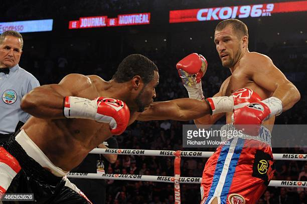 Sergey Kovalev dodges a body shot by Jean Pascal during their unified light heavyweight championship bout at the Bell Centre on March 14 2015 in...