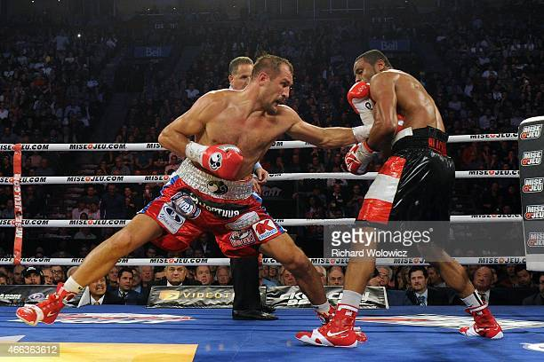 Sergey Kovalev land a body punch on Jean Pascal during their unified light heavyweight championship bout at the Bell Centre on March 14 2015 in...