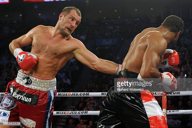Sergey Kovalev lands a body shot on Jean Pascal during their unified light heavyweight championship bout at the Bell Centre on March 14 2015 in...