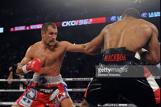 Sergey Kovalev lands a body shot to Jean Pascal during their unified light heavyweight championship bout at the Bell Centre on March 14 2015 in...