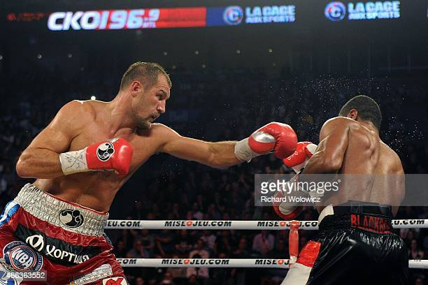 Sergey Kovalev lands a punch on Jean Pascal during their unified light heavyweight championship bout at the Bell Centre on March 14 2015 in Montreal...