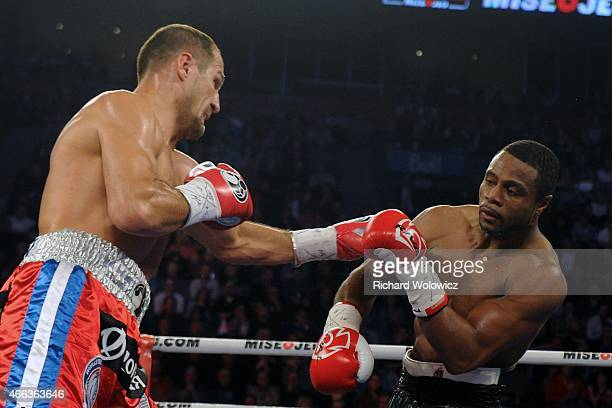 Sergey Kovalev lands a punch to the head of Jean Pascal during their unified light heavyweight championship bout at the Bell Centre on March 14 2015...
