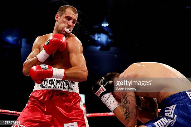 Sergey Kovalev loses his mouthguard during the WBO World LightHeavyweight Championship bout against Nathan Cleverly at Motorpoint Arena on August 17...