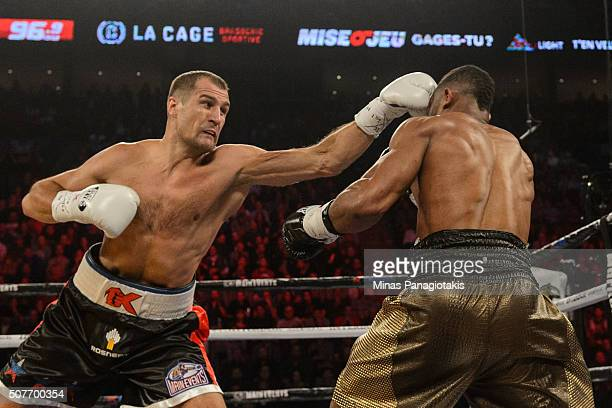 Sergey Kovalev of Russia lands a jab on Jean Pascal of Canada during the WBO WBA and IBF light heavyweight world championship match at the Bell...