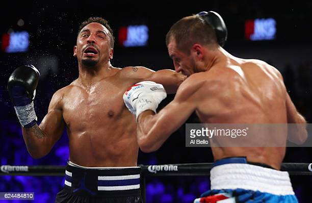 Sergey Kovalev of Russia lands a left hook to the head of Andre Ward during the second round of their light heavyweight title bout at TMobile Arena...