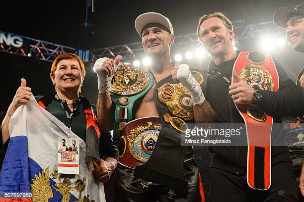 Sergey Kovalev of Russia poses for photos with his mom and with former NHL player Alexei Kovalev during the WBO WBA and IBF light heavyweight world...