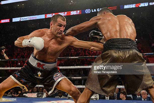 Sergey Kovalev of Russia punches Jean Pascal of Canada during the WBO WBA and IBF light heavyweight world championship match at the Bell Centre on...