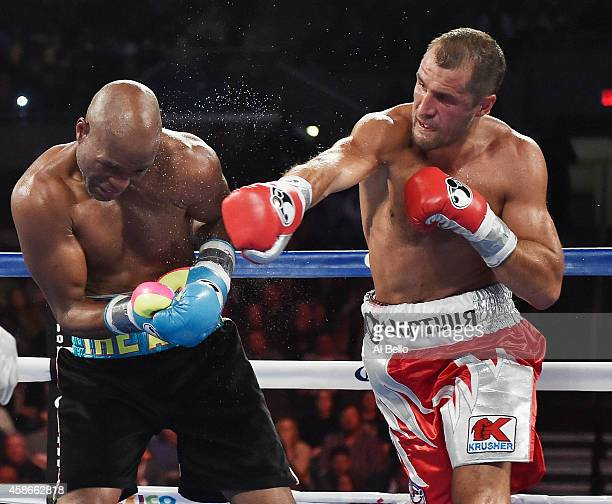 Sergey Kovalev punches Bernard Hopkins during their IBF WBA WBO Light Heavyweight title fight at Boardwalk Hall Arena on November 8 2014 in Atlantic...