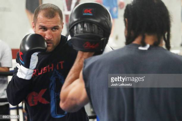 Sergey 'Krusher' Kovalev works out with trainer John David Jackson at the Boxing Laboratory on May 30 2017 in Oxnard California