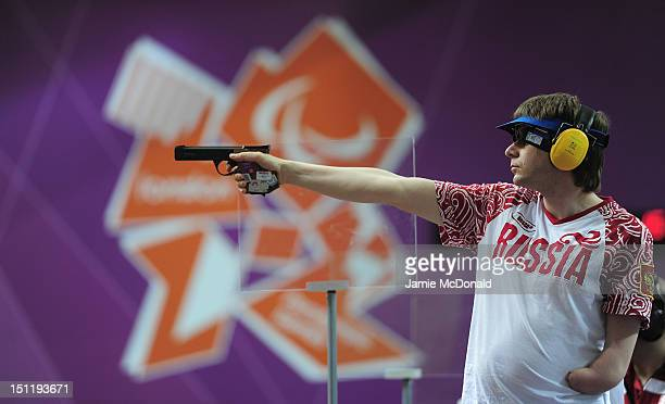 Sergey Malyshev of Russia shoots during the Mixed P325m Pistol SH1 Final on day 5 of the London 2012 Paralympic Games at The Royal Artillery Barracks...