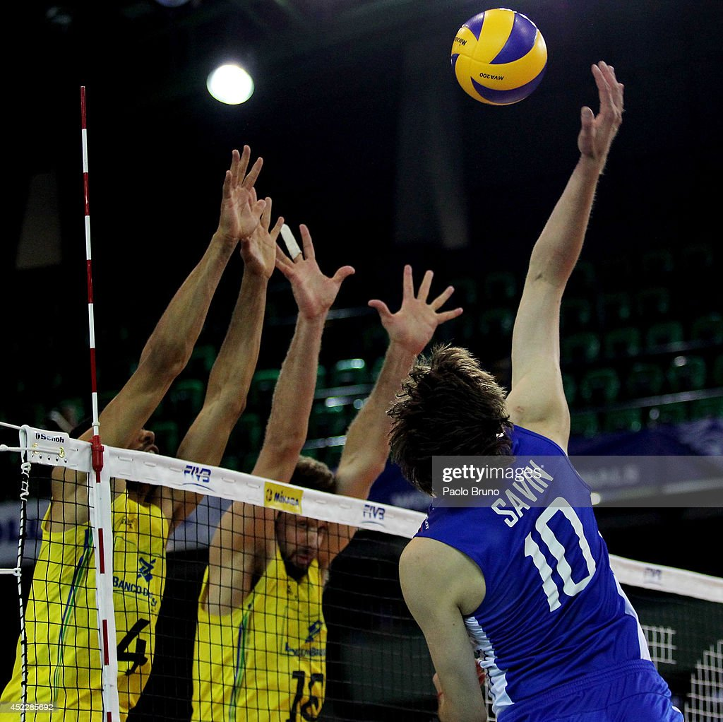 Sergey Savin of Russia spikes the ball during the FIVB World League Final Six match between Russia and Brazil at Mandela Forum on July 17, 2014 in Florence, Italy.