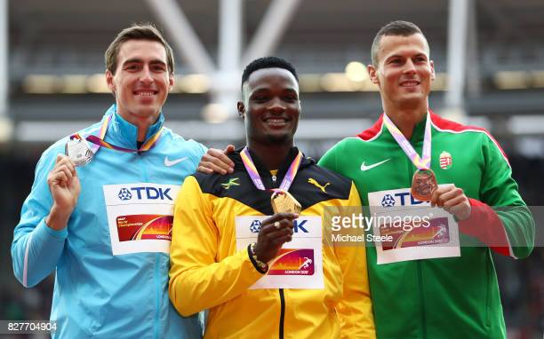 Sergey Shubenkov of Authorised Nuetral Athletes silver Omar McLeod of Jamaica gold and Balazs Baji of Hungary bronze pose with their medals for the...