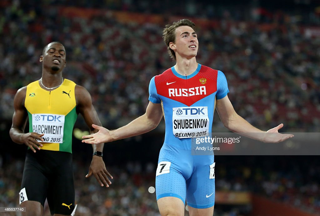 <a gi-track='captionPersonalityLinkClicked' href=/galleries/search?phrase=Sergey+Shubenkov&family=editorial&specificpeople=8099833 ng-click='$event.stopPropagation()'>Sergey Shubenkov</a> of Russia crosses the finish line to win gold in the Men's 110 metres hurdles final ahead of <a gi-track='captionPersonalityLinkClicked' href=/galleries/search?phrase=Hansle+Parchment&family=editorial&specificpeople=7242209 ng-click='$event.stopPropagation()'>Hansle Parchment</a> of Jamaica (L) during day seven of the 15th IAAF World Athletics Championships Beijing 2015 at Beijing National Stadium on August 28, 2015 in Beijing, China.