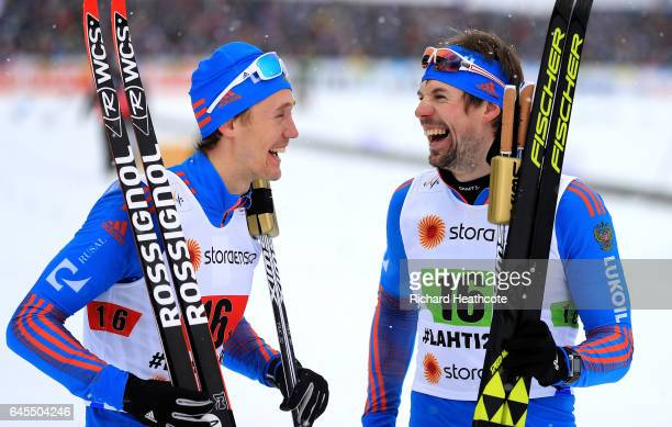 Sergey Ustiugov of Russia celebrate with team mate Nikita Kriukov the 1st place in the Men's and Women's Cross Country Team Sprint Final during the...