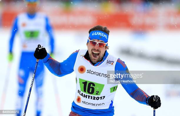 Sergey Ustiugov of Russia celebrates after crossing the finish line in the Men's and Women's Cross Country Team Sprint Final during the FIS Nordic...