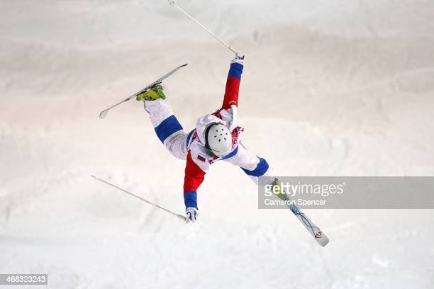 Sergey Volkov of Russia loses control of his jump in the Men's Moguls Qualification on day three of the Sochi 2014 Winter Olympics at Rosa Khutor...