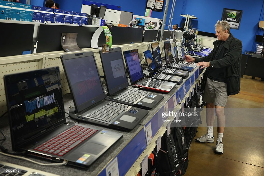 Sergey Zaks shops for a laptop computer at a Tiger Direct store on April 11, 2013 in Chicago, Illinois. According to a recent report sales of personal computers have been experiencing double-digit declines as consumers look toward tablets and smart phones to fill their computing needs.