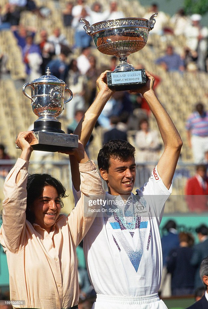 Sergi Bruguera and Arantxa Sanchez Vicario of Spain holds up their championship trophy's after they won the singles tittles during the 1994 French Open Championships June 5, 1994 at Stade Roland Garros in Paris, France.