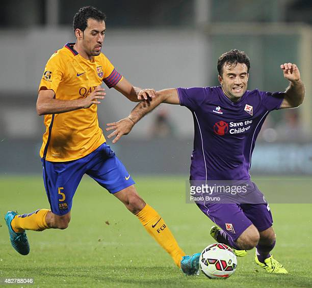 Sergi Busquets of FC Barcelona competes for the ball with Giuseppe Rossi of ACF Fiorentina during the preseason friendly match between ACF Fiorentina...