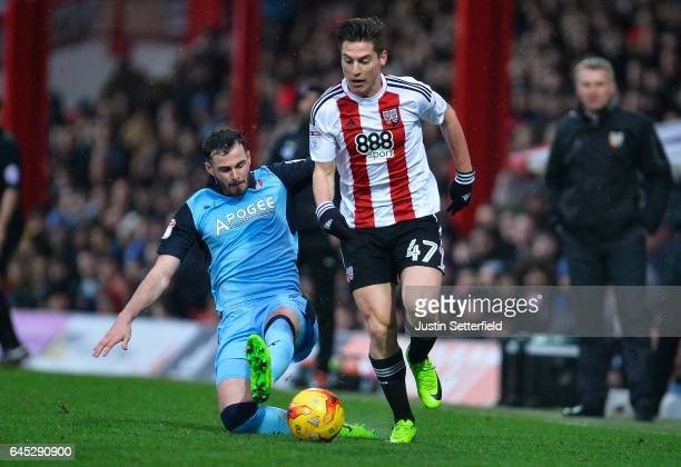 Sergi Canos of Brentford FC and Anthony Forde of Rotherham during the Sky Bet Championship match between Brentford and Rotherham at Griffin Park on...