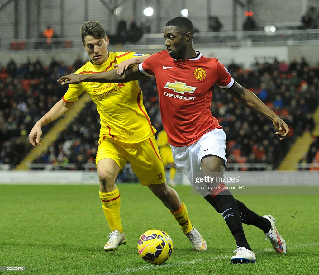 Sergi Canos of Liverpool and Tyler Blackett of Manchester United in action during the Barclays U21 Premier League match between Manchester United and Liverpool at Leigh Sports Village on January 26, 2015 in Leigh, Greater Manchester.