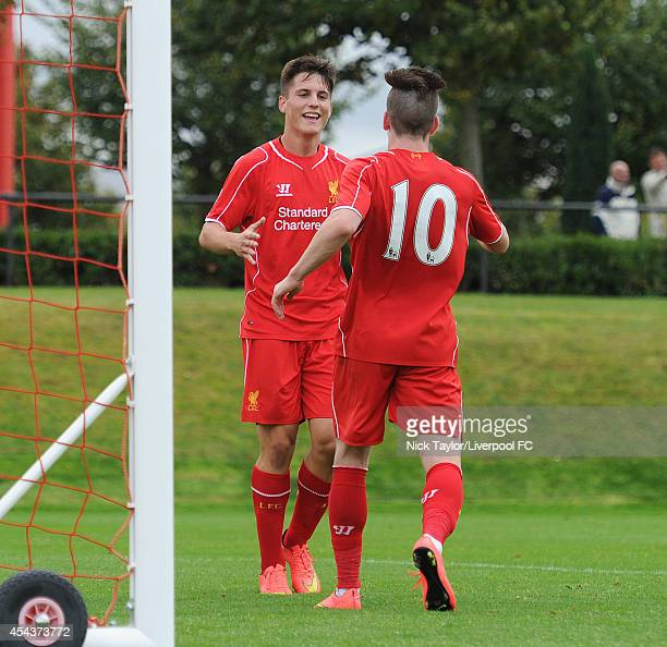 Sergi Canos of Liverpool congratulates team mate Ryan Kent on his goal during the Barclays Premier League Under 18 fixture between Liverpool and...