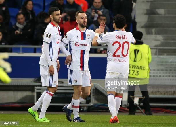 Sergi Darder of Lyon celebrates his goal between Rachid Ghezzal and Rafael da Silva of Lyon during the UEFA Europa League Round of 32 second leg...