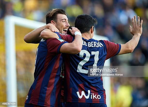 Sergi Enrich Ametller of Eibar celebrates scoring his team's first goal with his teammate Saul Berjon during the La Liga match between Villarreal CF...